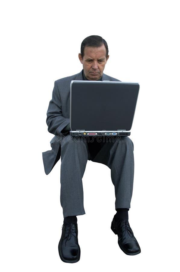 Hombre de negocios con la computadora portátil aislada foto de archivo libre de regalías