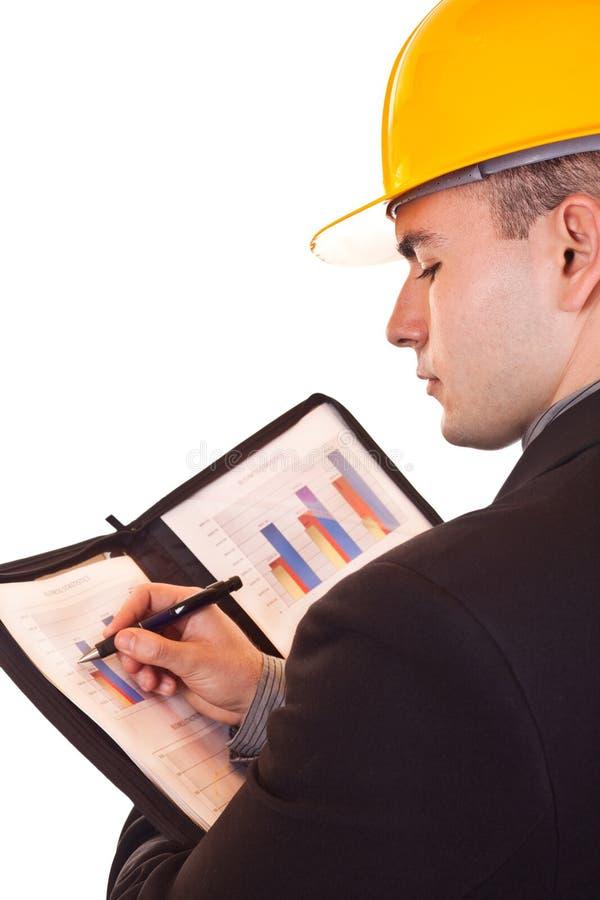 Hombre de negocios con la escritura del casco imagen de archivo libre de regalías