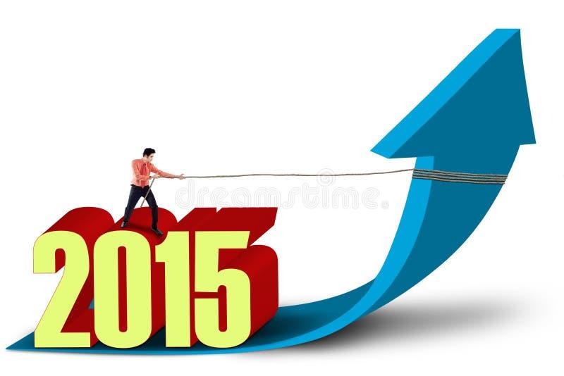 Hombre de negocios con la flecha ascendente y el número 2015 libre illustration