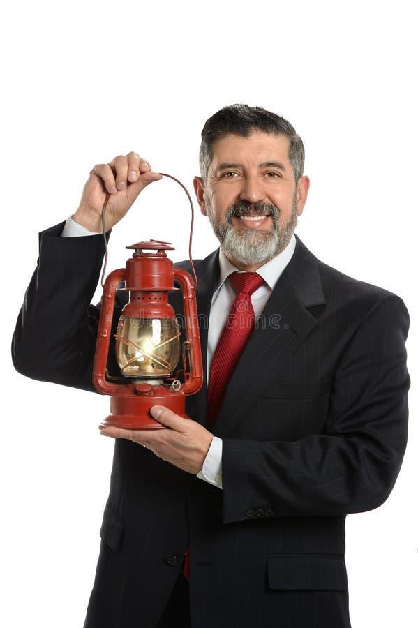 Hombre de negocios con la linterna imagen de archivo