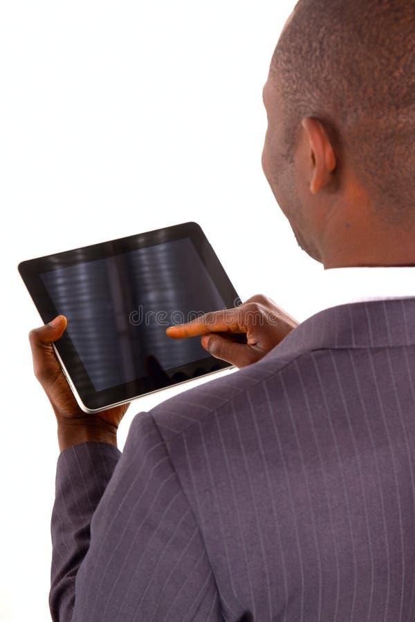 Hombre de negocios con la tablilla fotografía de archivo libre de regalías