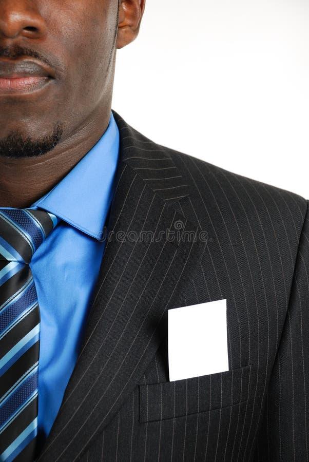 Hombre de negocios con la tarjeta de visita en el bolsillo foto de archivo libre de regalías