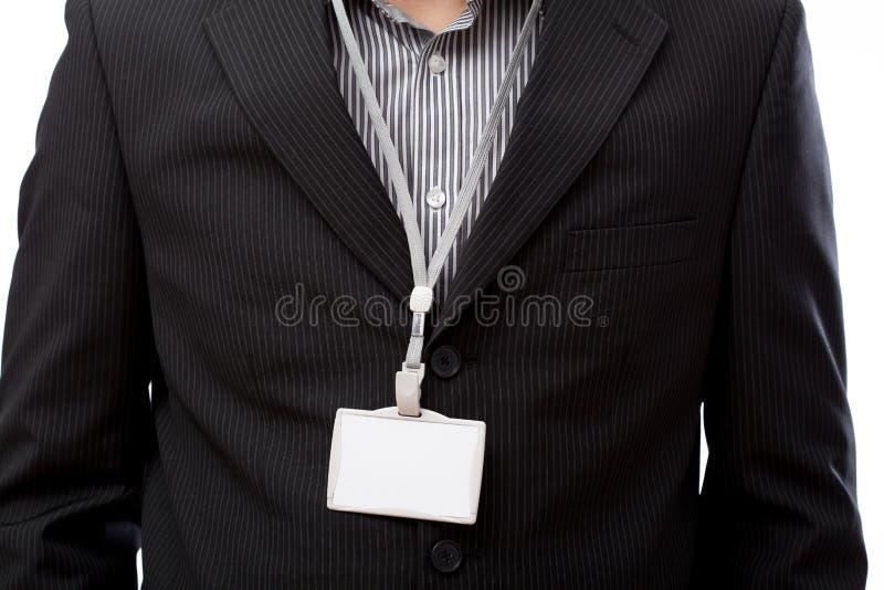 Hombre de negocios con la tarjeta vacía de la identificación fotografía de archivo