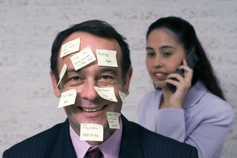 Hombre de negocios con las notas pegajosas fotos de archivo libres de regalías