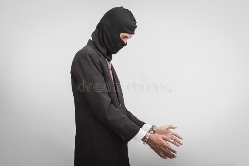 Hombre de negocios con los grillos en blanco imagen de archivo libre de regalías