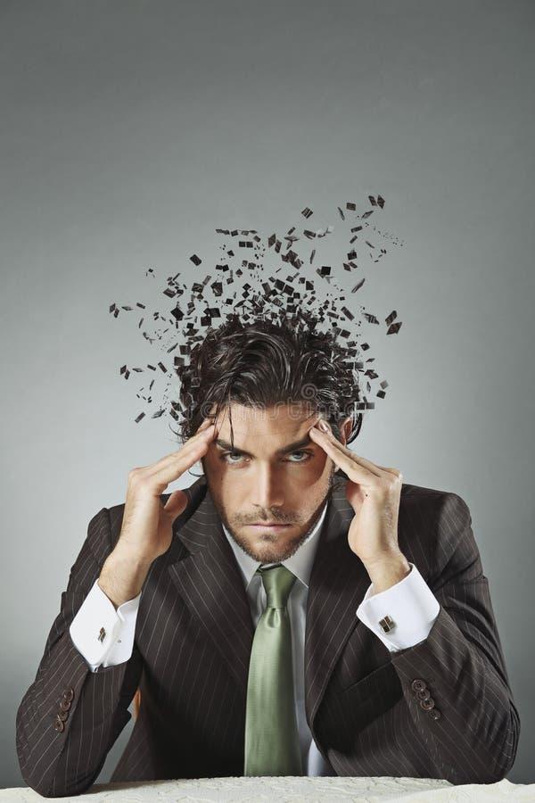 Hombre de negocios con mente dispersada fotografía de archivo