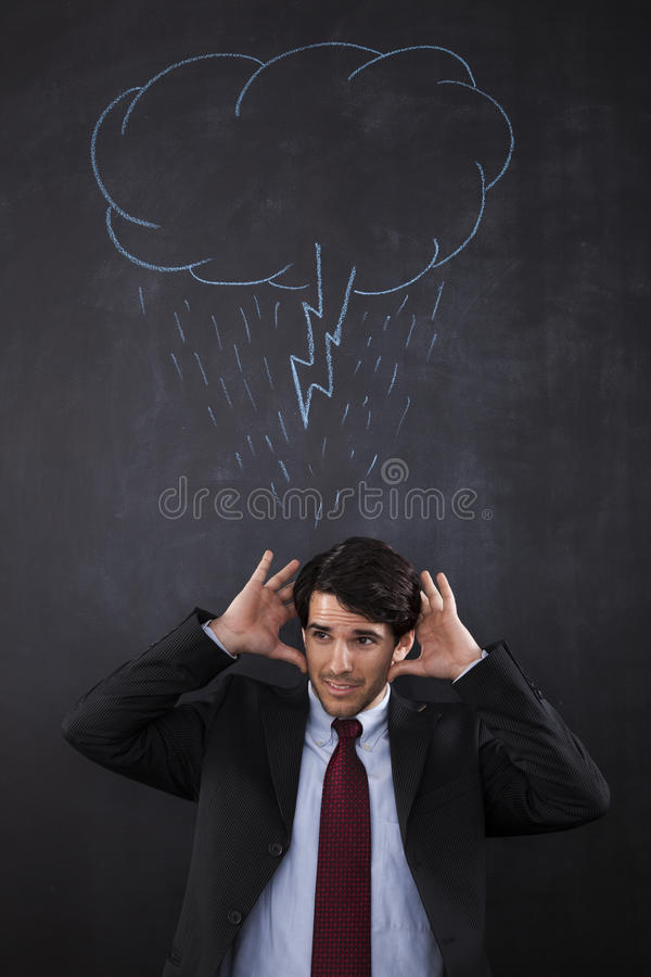 Hombre de negocios con un abouve de la nube de tormenta su cabeza fotografía de archivo libre de regalías