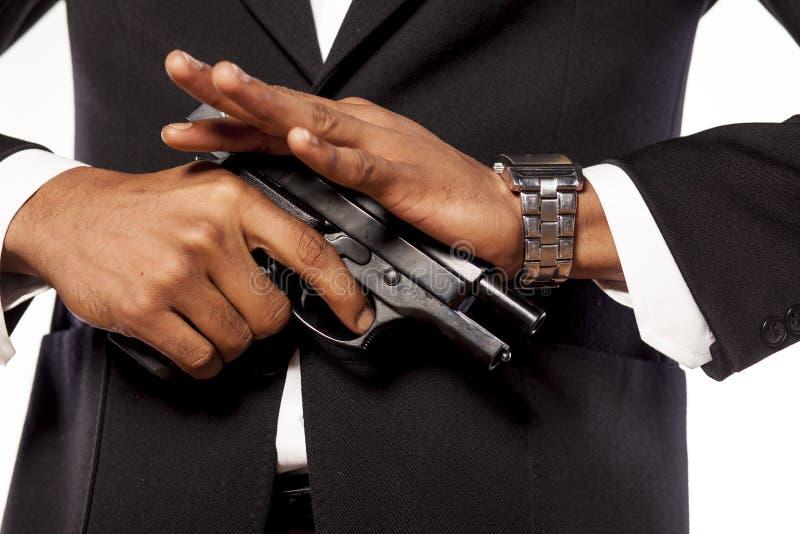 Hombre de negocios con un arma imagen de archivo libre de regalías