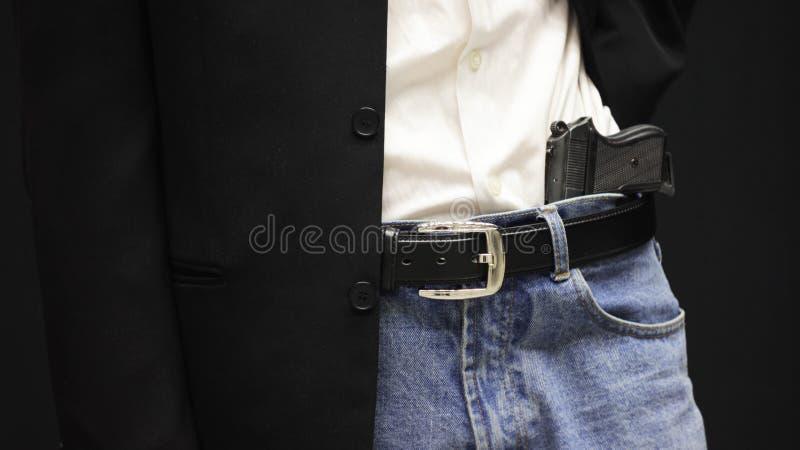 Hombre de negocios con un arma fotos de archivo libres de regalías