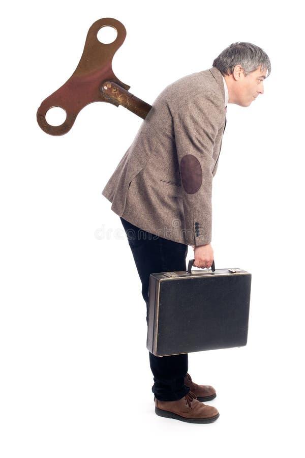 Hombre de negocios con un viento encima de la llave fotos de archivo