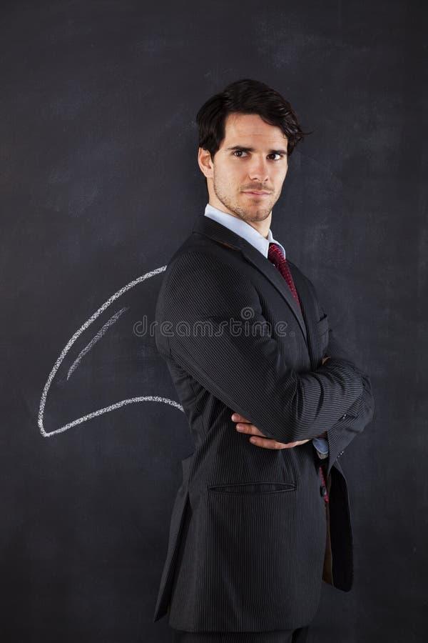 Hombre de negocios con una aleta del tiburón foto de archivo libre de regalías
