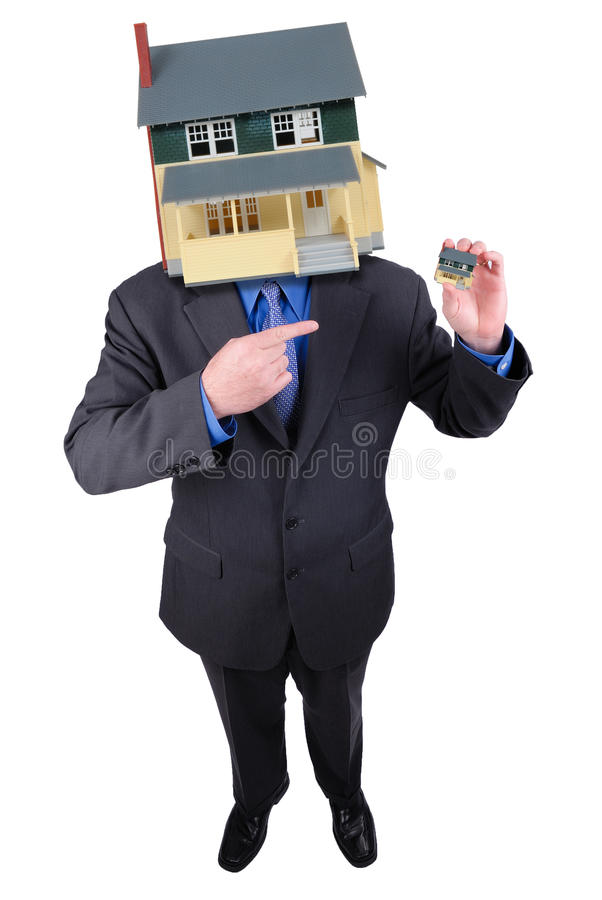 Hombre de negocios con una pista de la casa fotografía de archivo