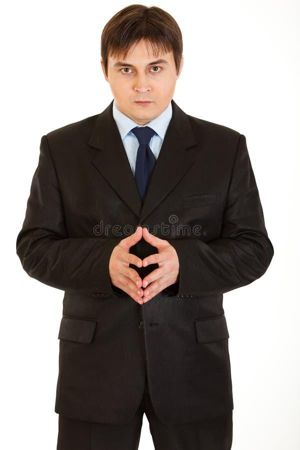 Hombre de negocios concentrado que piensa en algo fotos de archivo