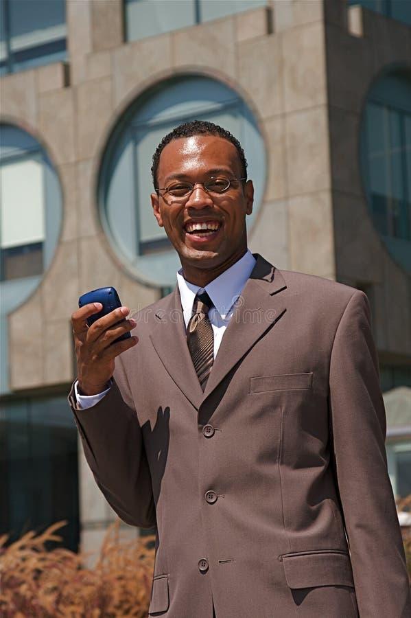 Hombre de negocios confidente joven imagenes de archivo