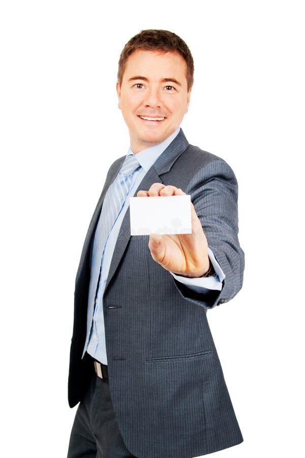 Hombre de negocios confidente que sostiene la tarjeta de visita en blanco fotos de archivo