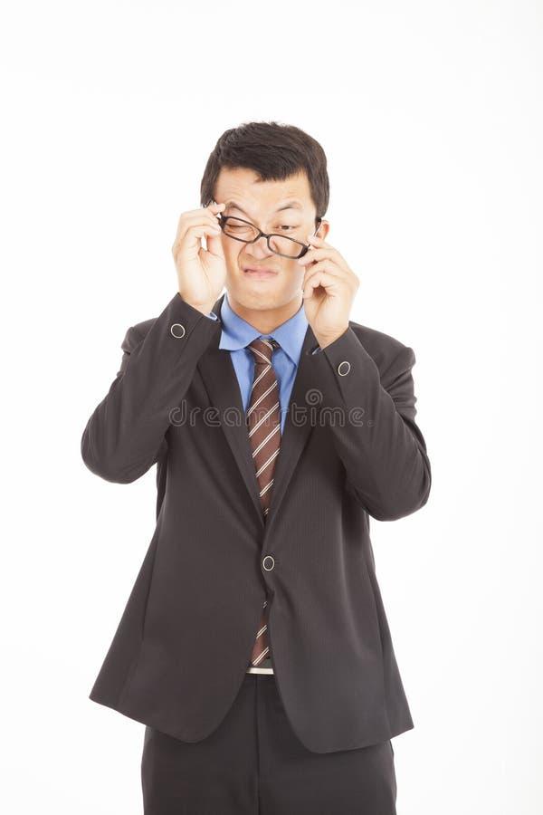 Hombre de negocios confuso con los vidrios foto de archivo