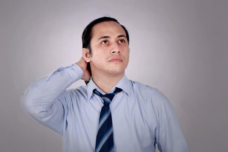 Hombre de negocios confuso Thinking Expression foto de archivo libre de regalías