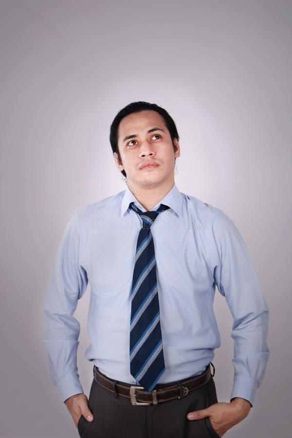 Hombre de negocios confuso Thinking Expression fotografía de archivo libre de regalías