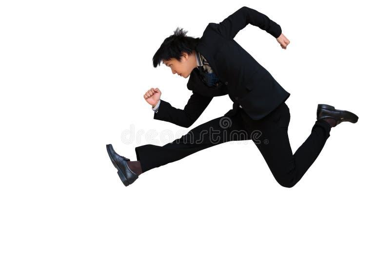 Hombre de negocios de funcionamiento y de salto fotografía de archivo