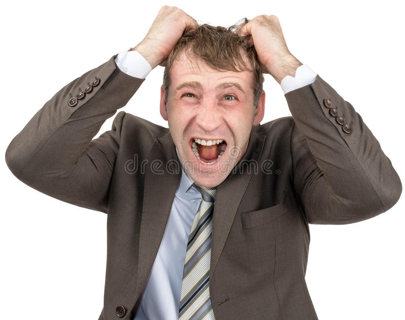 Hombre de negocios de griterío que rasga su pelo imagen de archivo