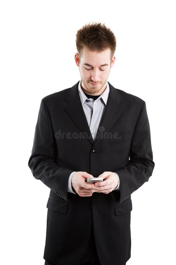Hombre de negocios del caucásico de Texting foto de archivo