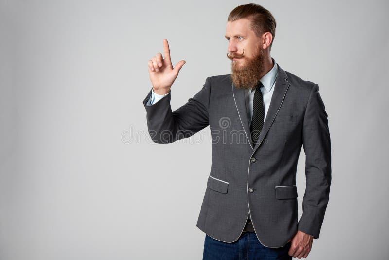 Hombre de negocios del inconformista que mira al lado fotos de archivo libres de regalías