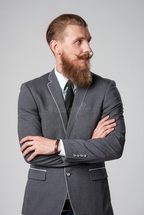 Hombre de negocios del inconformista que mira al lado fotografía de archivo libre de regalías