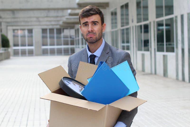 Hombre de negocios desesperado que consigue encendido aislado foto de archivo libre de regalías