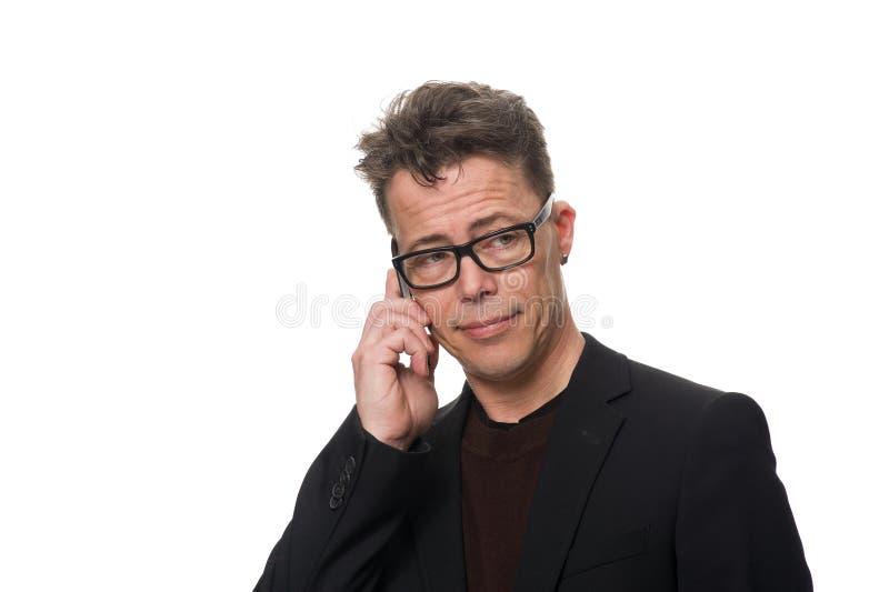 Hombre de negocios dudoso Isolated en el fondo blanco imagen de archivo