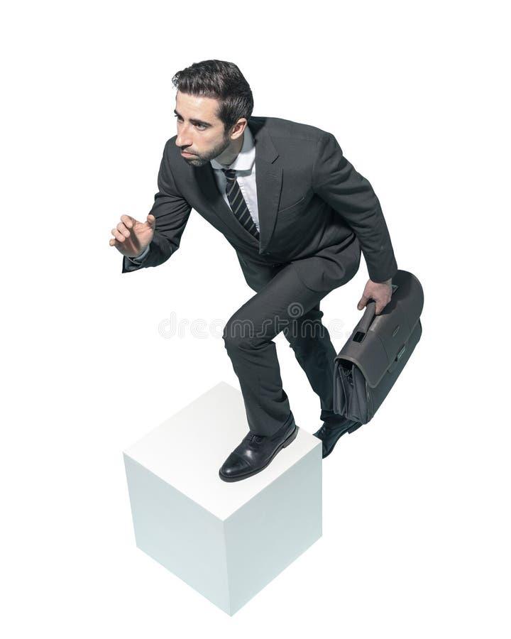 Hombre de negocios eficiente que corre con su cartera imagen de archivo libre de regalías