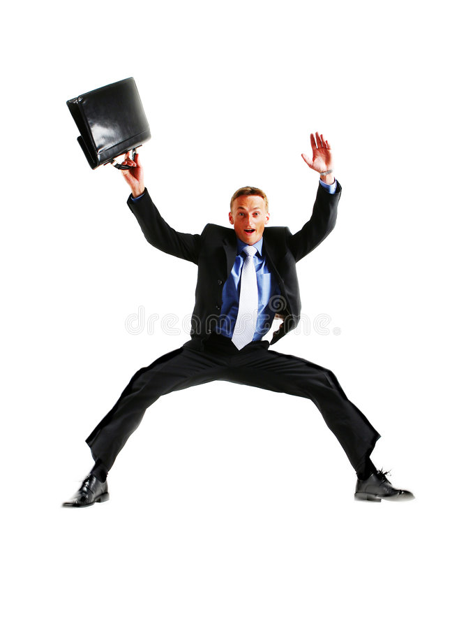 Hombre de negocios enérgio muy feliz que salta en fotografía de archivo libre de regalías