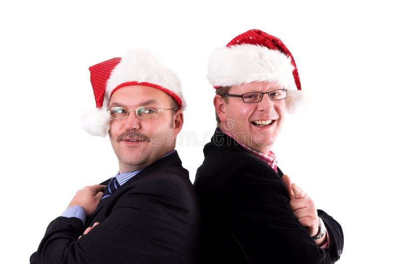 Hombre de negocios en alcohol de la Navidad imagen de archivo