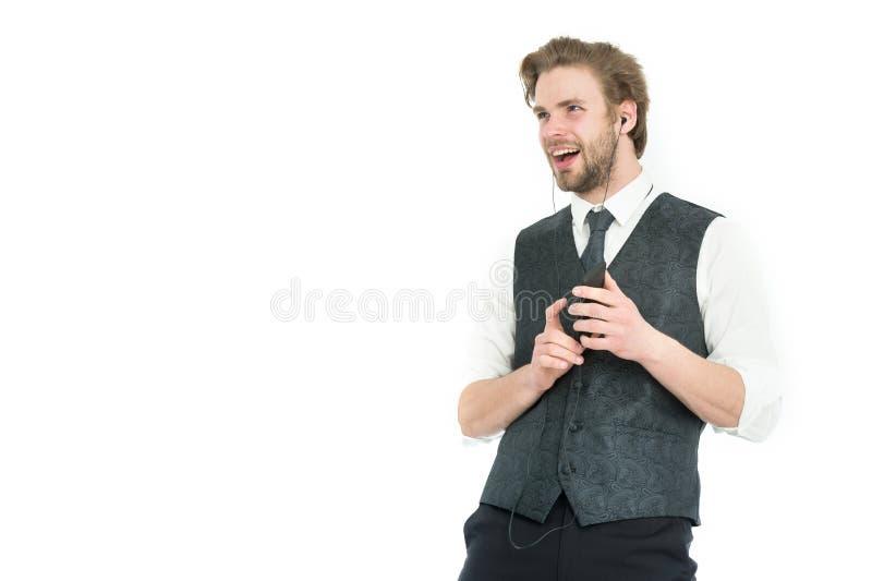 Hombre de negocios en auriculares con el teléfono celular fotos de archivo