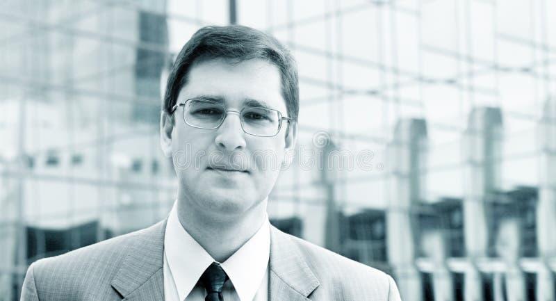 Hombre de negocios en azul foto de archivo libre de regalías