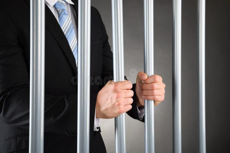 Hombre de negocios en cárcel imágenes de archivo libres de regalías