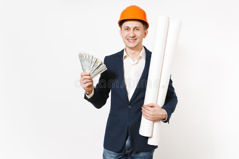 Hombre de negocios en cuestión joven en traje oscuro, paquete protector de la tenencia del casco de protección de dólares, dinero imagen de archivo