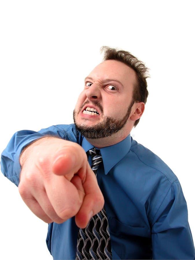 Hombre de negocios en el azul (enloquecido y el señalar) imagen de archivo libre de regalías