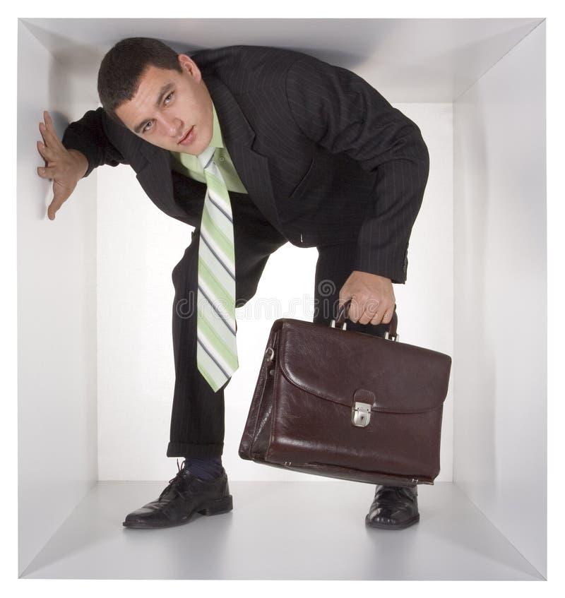 Hombre de negocios en el cubo foto de archivo