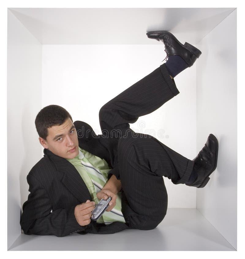 Hombre de negocios en el cubo foto de archivo libre de regalías