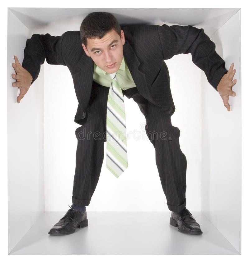 Hombre de negocios en el cubo fotos de archivo libres de regalías