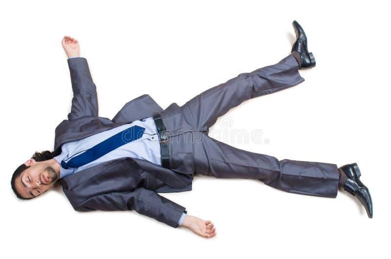 Hombre de negocios en el piso aislado en blanco fotos de archivo libres de regalías