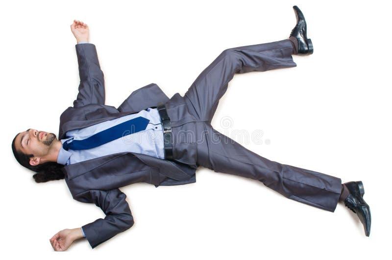 Hombre de negocios en el piso aislado en blanco foto de archivo