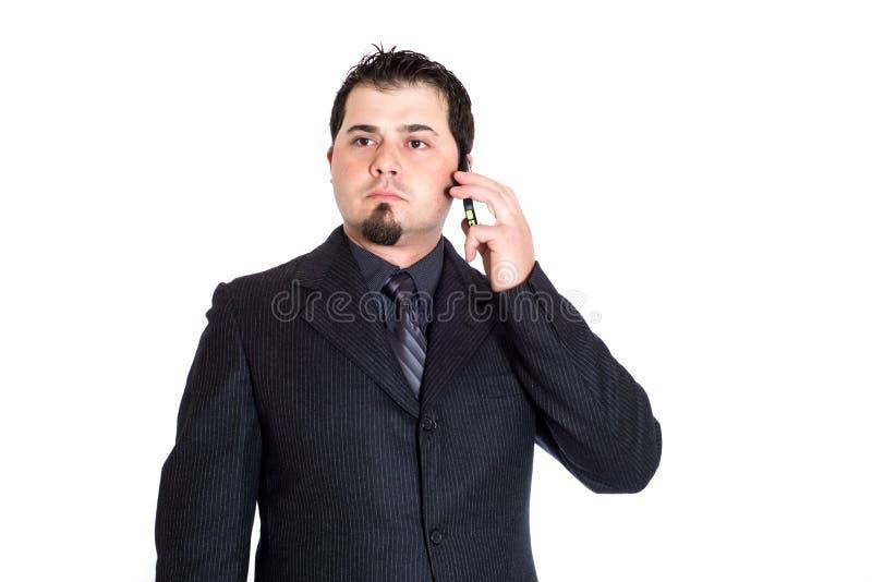 Hombre de negocios en el teléfono distraído fotos de archivo libres de regalías
