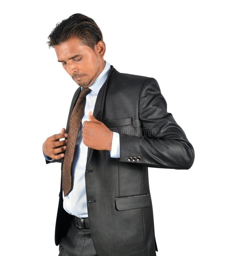 Hombre de negocios en el traje negro que consigue listo foto de archivo
