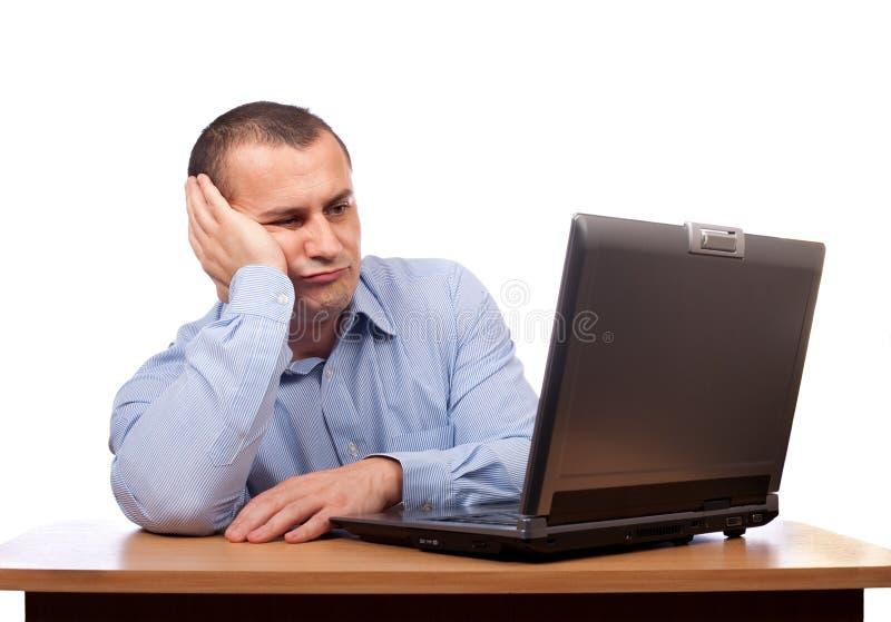 Hombre de negocios en la computadora portátil fotos de archivo