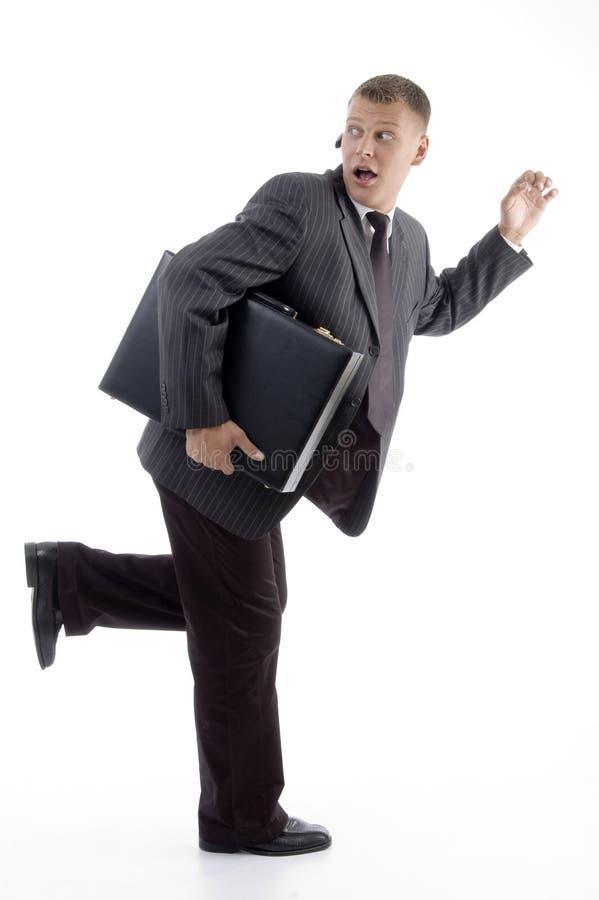 Hombre de negocios en prisa con la cartera fotos de archivo libres de regalías