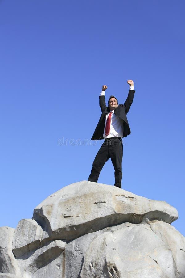 Hombre de negocios en roca imágenes de archivo libres de regalías