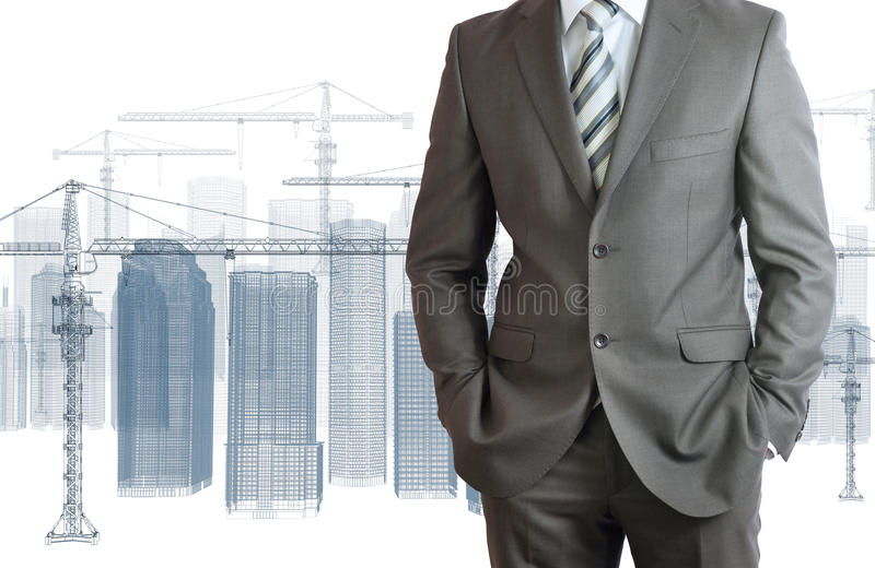 Hombre de negocios en traje. Y rascacielos de grúa imagen de archivo libre de regalías