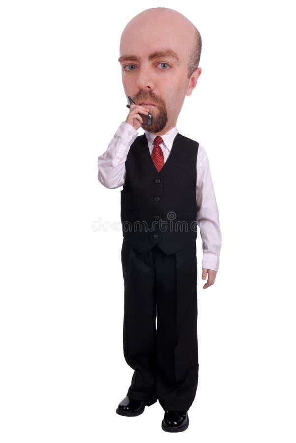 Hombre de negocios en un teléfono celular fotos de archivo