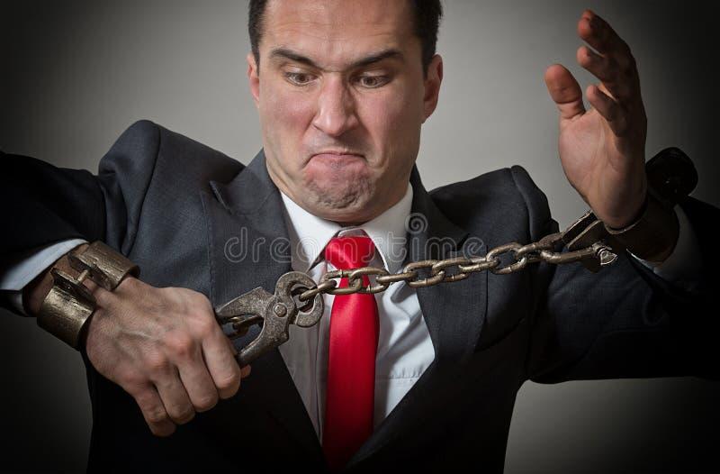 Hombre de negocios encadenado foto de archivo libre de regalías